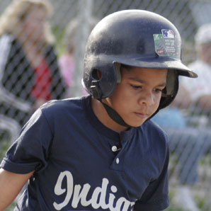 nine-year-old boy playing Little League baseball