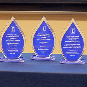 table arrayed with award trophies